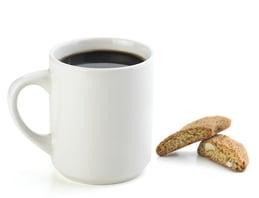 Coffee mug with coffee and scone